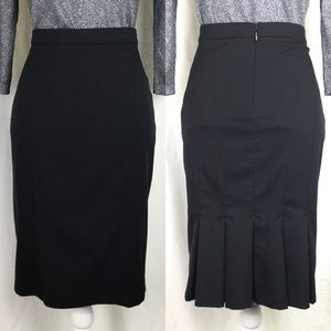 Black pencil skirt with pleated back detail